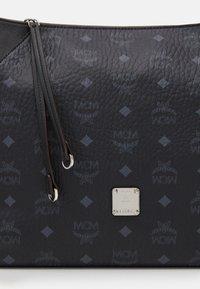 MCM - KLARA VISETOS  - Handbag - black - 4