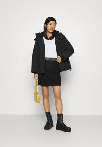 Calvin Klein Jeans - ECO PUFFER JACKET - Vinterjakke - black - 1