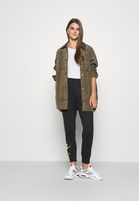 Nike Sportswear - AIR PANT   - Tracksuit bottoms - black - 1