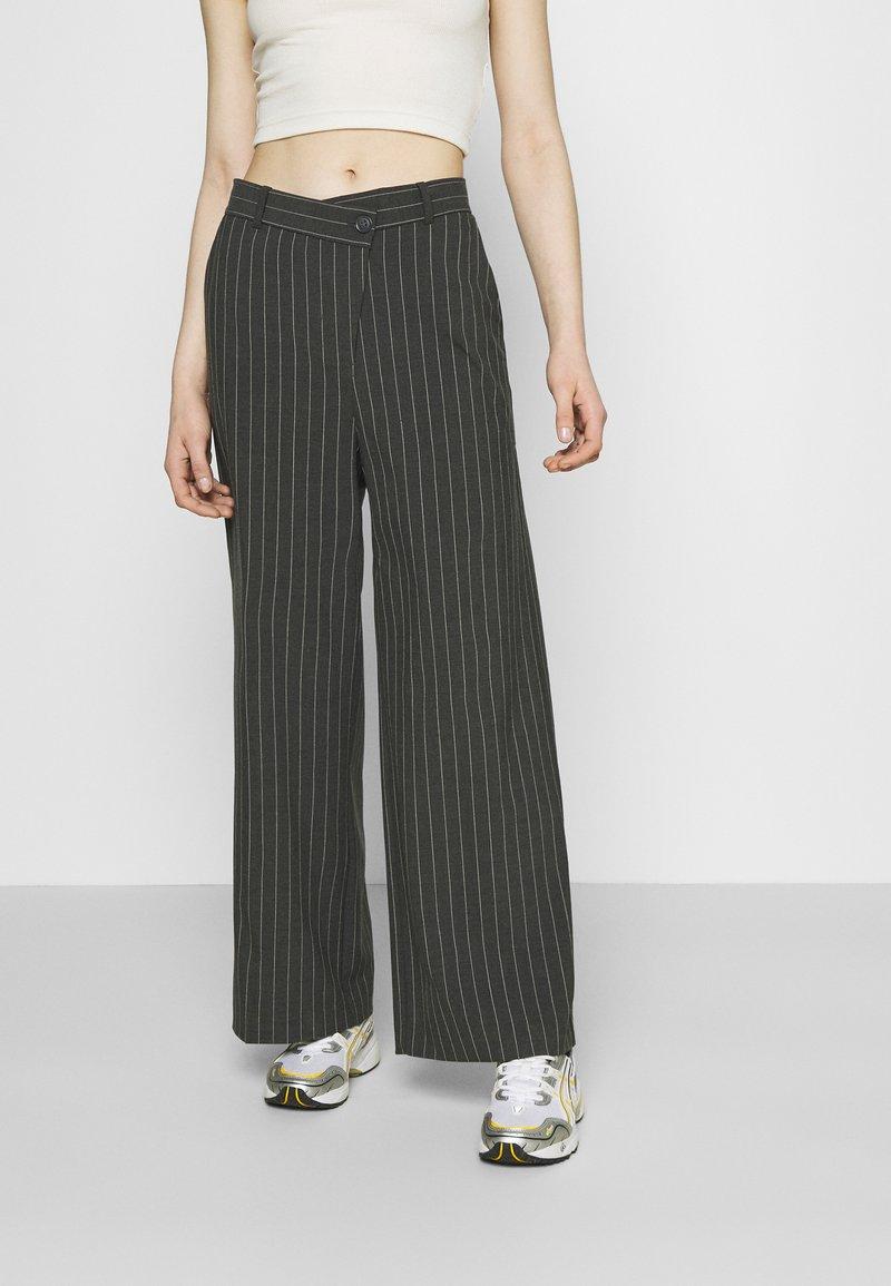 Weekday - LUXA SKEW TROUSERS - Trousers - grey