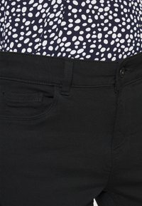 Vero Moda - VMHONNISEVEN PUSH UP - Jeans Skinny Fit - black - 4