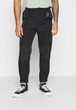 HARDWARE TROUSERS - Cargo trousers - black