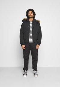 Calvin Klein Jeans - TRIMMED JACKET - Down jacket - black - 1