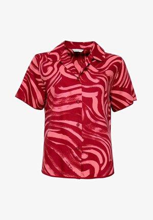 Pyjama top - red spiral