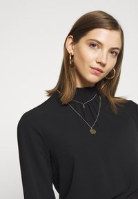 ONLY - ONLNOVA LUX  SOLID - Blouse - black