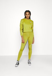 The North Face - TIGHT - Leggings - Trousers - citronelle green - 1