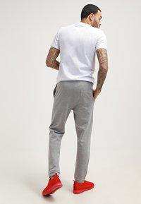 YOURTURN - Tracksuit bottoms - mottled grey - 2