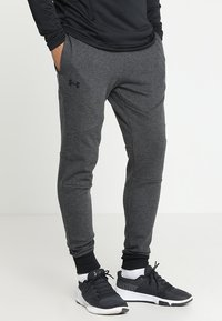 Under Armour - UNSTOPPABLE JOGGER - Tracksuit bottoms - black/black - 0