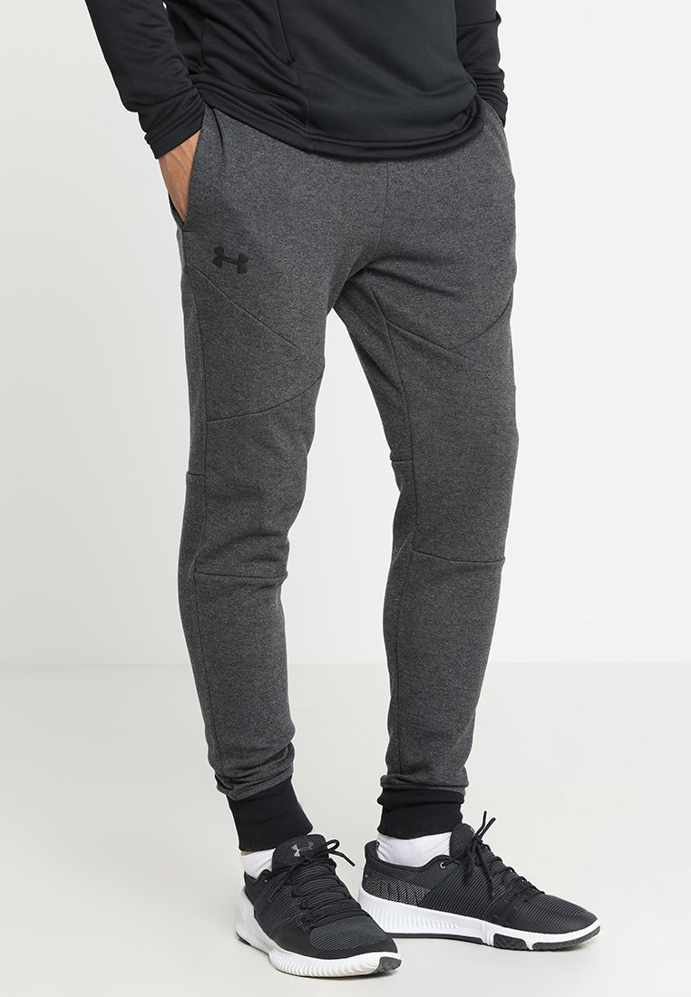 Under Armour - UNSTOPPABLE JOGGER - Tracksuit bottoms - black/black