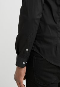 Emporio Armani - CAMICIA - Camisa - black - 3