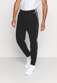 Lacoste Sport - PANT TAPERED - Tracksuit bottoms - black - 0