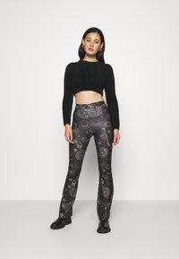 Topshop - ASTROLOGY FLARE - Leggings - Trousers - black - 1