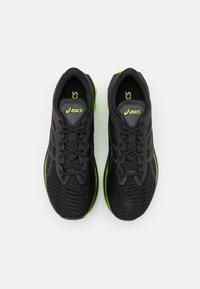 ASICS - NOVABLAST - Neutral running shoes - black/lime zest - 3