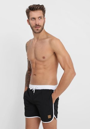 RETRO - Swimming shorts - black/white
