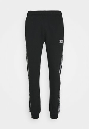 TAPED  - Pantalones deportivos - black