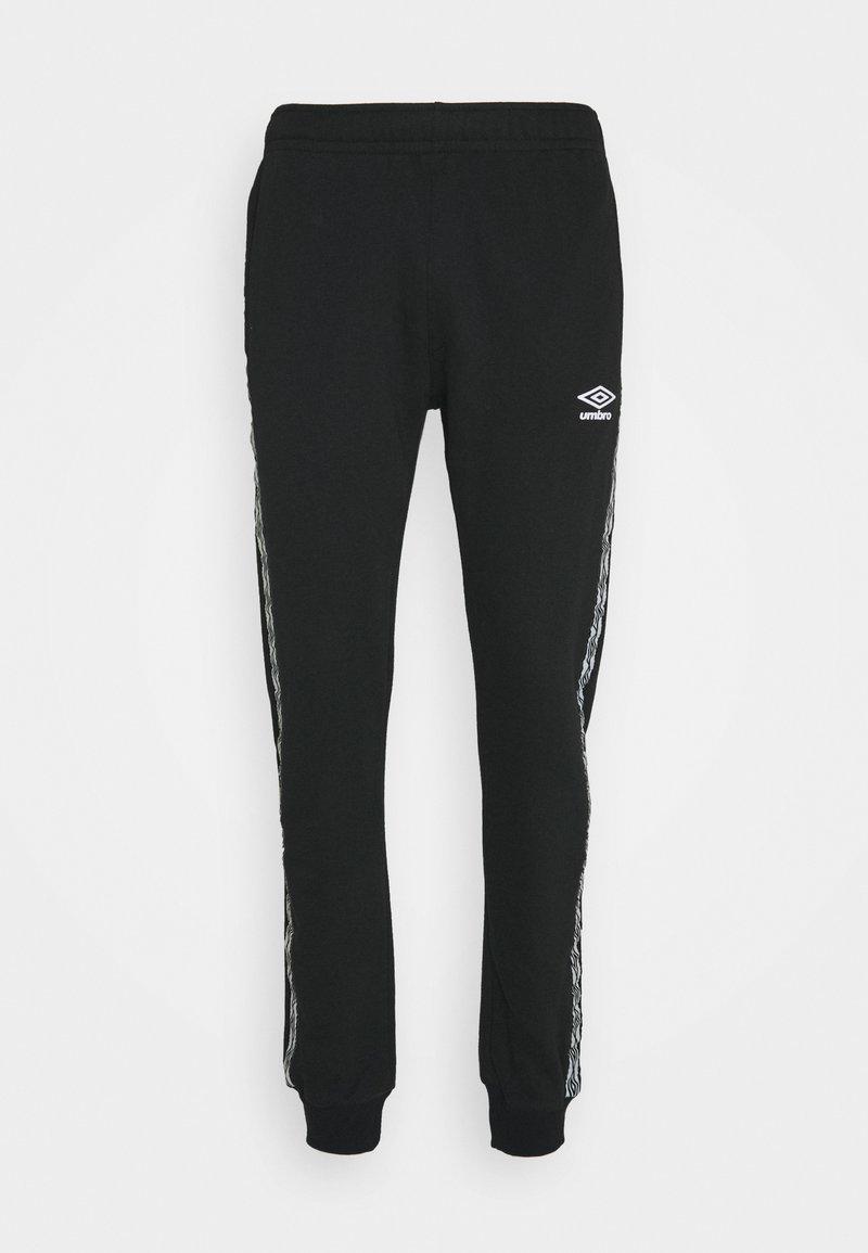 Umbro - TAPED  - Teplákové kalhoty - black