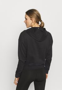 Puma - TRAIN FAVORITE FULL ZIP - Zip-up hoodie - black - 2