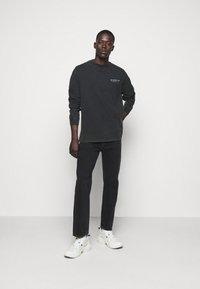 The Kooples - JEAN - Straight leg jeans - black - 1