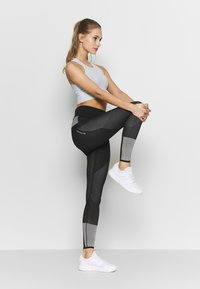 adidas Performance - CROP - Top - skytin - 1