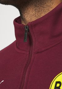 Puma - BVB BORUSSIA DORTMUND CULTURE TRACK  - Club wear - burgundy/cyber yellow - 4