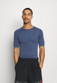 Nike Performance - T-shirts - mystic navy/black - 0
