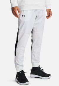 Under Armour - Tracksuit bottoms - white - 0