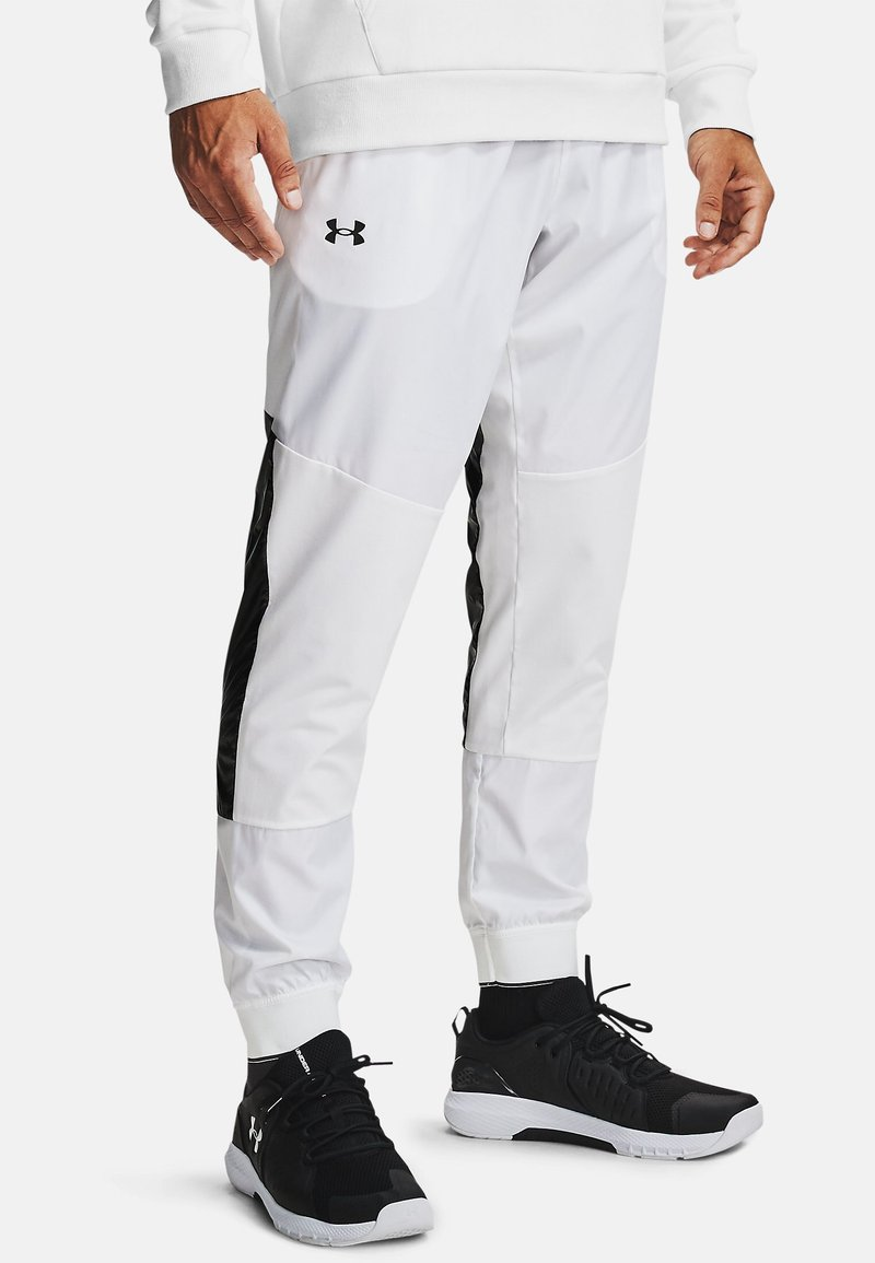Under Armour - Tracksuit bottoms - white