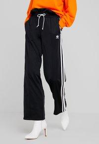 adidas Originals - BELLISTA 3 STRIPES PANTS - Träningsbyxor - black - 0