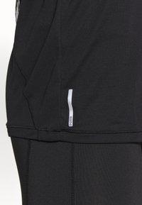 Puma - STUDIO KEYHOLE TEE - Basic T-shirt - black - 4