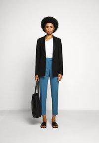 HUGO - HAMIRA - Trousers - dark blue - 1