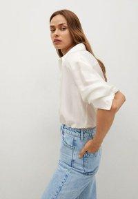 Mango - CAROL - Flared Jeans - light blue - 5