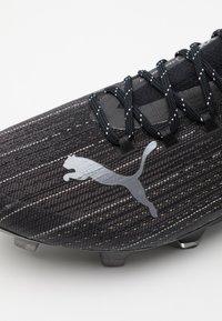 Puma - ULTRA 1.1 FG/AG - Voetbalschoenen met kunststof noppen - black - 5