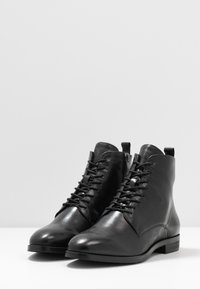 Caprice - Lace-up ankle boots - black - 4