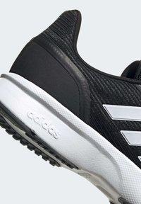 adidas Performance - NOVA FLOW SHOES - Zapatillas de running neutras - black - 8