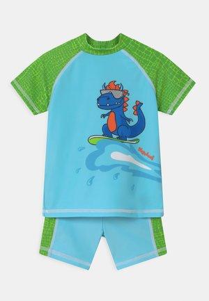 UV-SCHUTZ DINO SET - Koszulki do surfowania - blau/grün