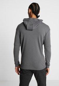 Nike Performance - Jersey con capucha - iron grey/black - 2