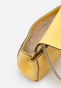 Guess - SANDRINE CONVERTIBLE CROSSBODY - Across body bag - yellow - 3