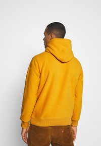 Levi's® - HOODIE UNISEX - Luvtröja - golden yellow - 2
