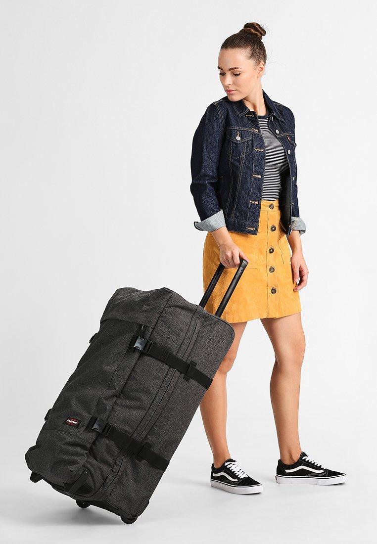 Eastpak - TRANVERZ L CORE COLORS - Wheeled suitcase - black denim