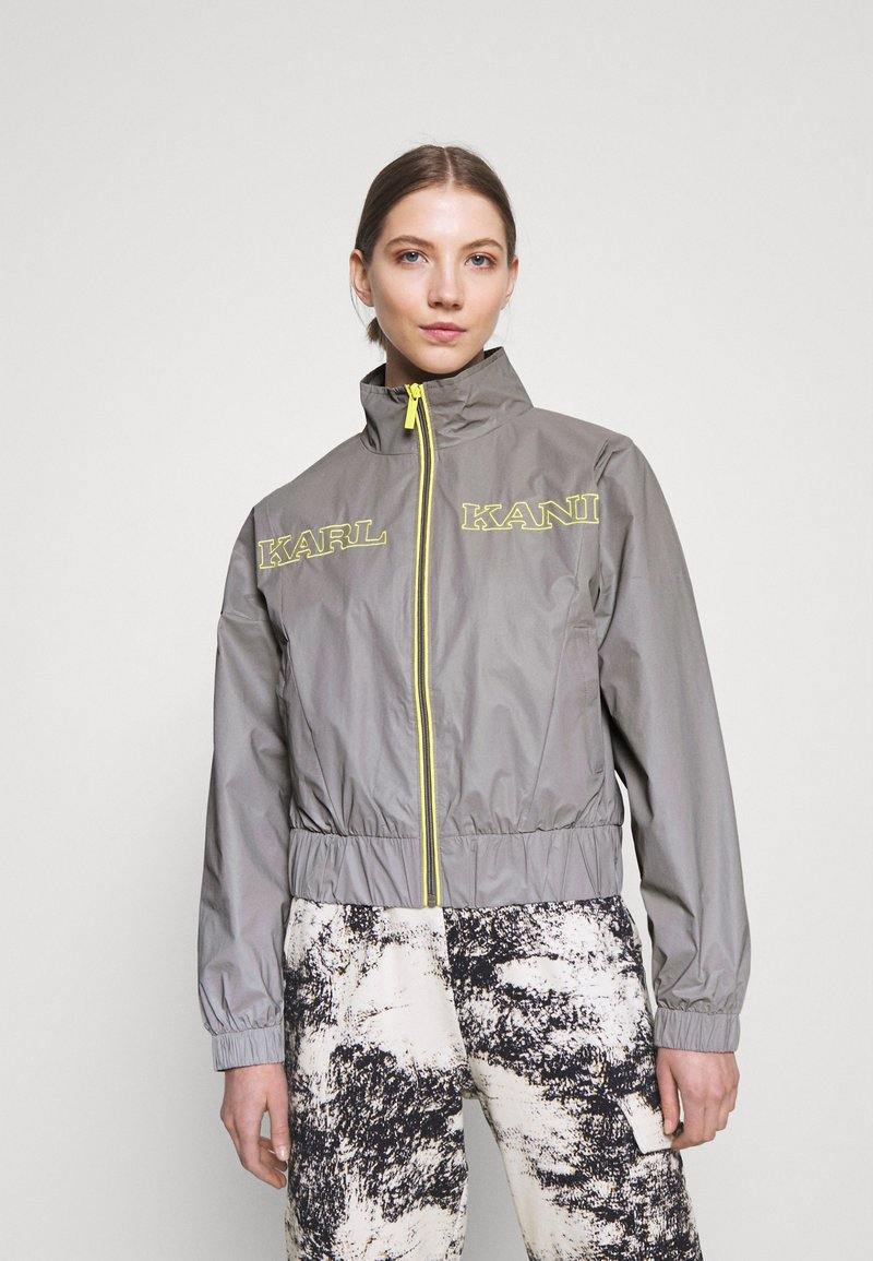 Karl Kani - RETRO SHINY SHORT TRACKJACKET - Summer jacket - grey
