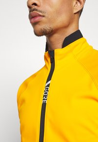 Gore Wear - INFINIUM™ THERMO - Trainingsjacke - bright orange - 3