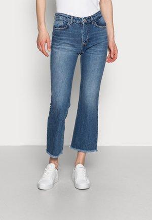 LINDA - Flared Jeans - blue denim