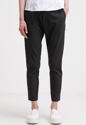 KRISSY - Trousers - black