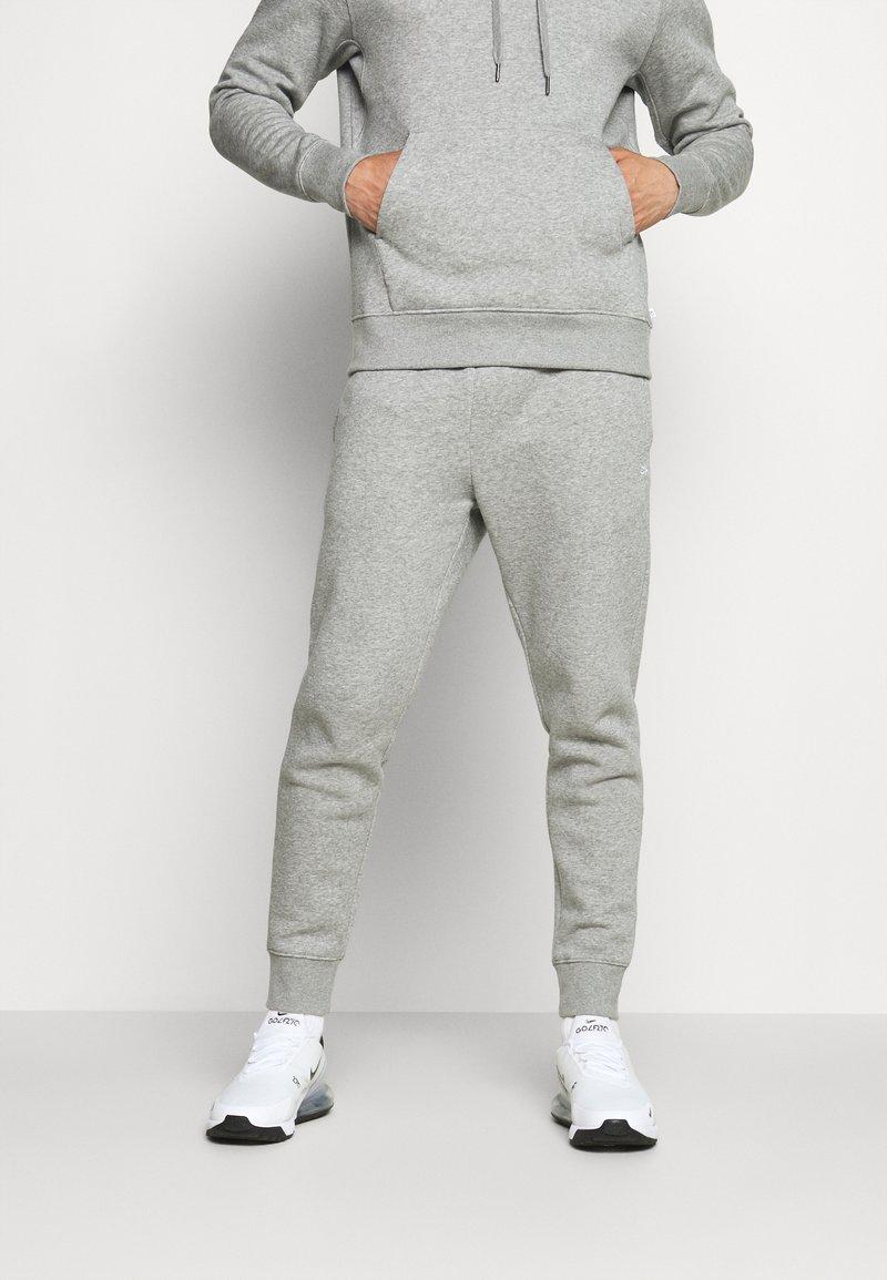 Calvin Klein Golf - PLANET - Tracksuit bottoms - grey