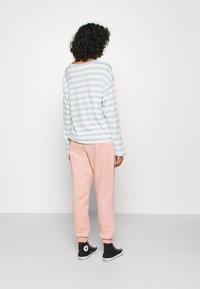 Topshop - SHIRRED WAIST - Tracksuit bottoms - pink - 2