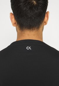 Calvin Klein Performance - LONG SLEEVE - Long sleeved top - black - 3