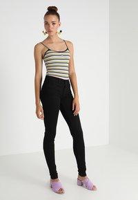 Levi's® - 710 SUPER SKINNY - Jeans Skinny - black galaxy - 1