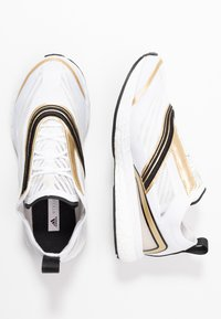 adidas by Stella McCartney - BOSTON S. - Zapatillas de running neutras - footwear white/golden butter - 1