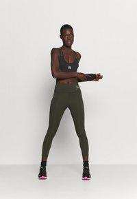 Ellesse - GRIZA - Medium support sports bra - black - 1