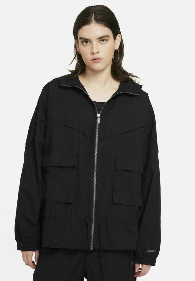 W NSW ICN CLSH JKT WR CANVAS - Training jacket - black/dark smoke grey